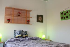 Кровать или кровати в номере Alghero 4u Self Check in