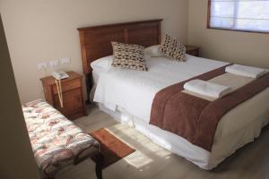 Кровать или кровати в номере Hotel Plaza Pinto