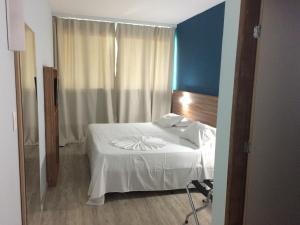 Cama ou camas em um quarto em Hotel Canoeiros