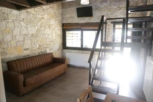 A seating area at Gioulis Apartments & Studios