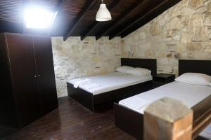 A bed or beds in a room at Gioulis Apartments & Studios