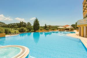 The swimming pool at or near Dolce CampoReal Lisboa