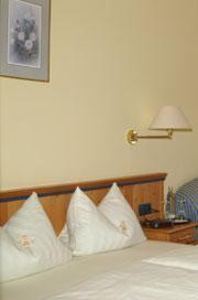 Кровать или кровати в номере Steinburger Hof