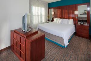 A bed or beds in a room at Residence Inn Dover