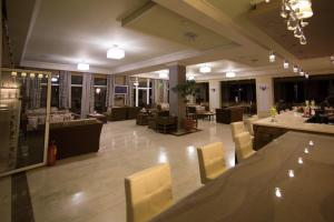A restaurant or other place to eat at Aphrodite Hotel