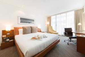 A bed or beds in a room at Novotel Canberra