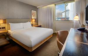 A bed or beds in a room at Hilton Leeds City