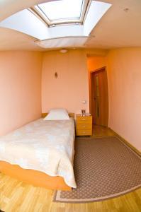 Кровать или кровати в номере Пит Стоп