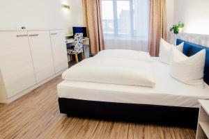 Ein Bett oder Betten in einem Zimmer der Unterkunft Fair Hotel Mönchengladbach City