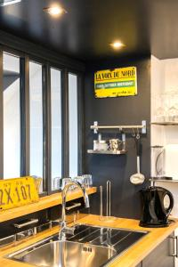 The lounge or bar area at Little Suite - Marius et Romain