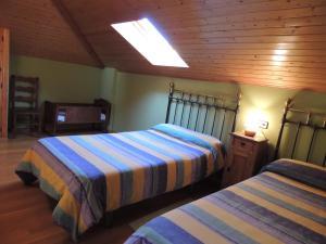 Cama o camas de una habitación en El Encinar