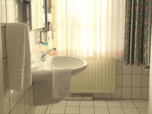 Ein Badezimmer in der Unterkunft Landhaus Bisping