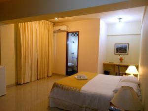 Кровать или кровати в номере Hotel Pousada de Minas