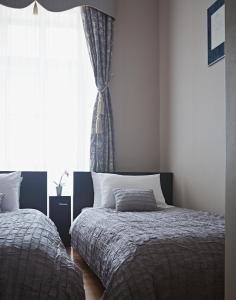 Letto o letti in una camera di Apartments Almandine