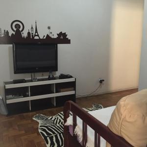Uma área de estar em Apartamento Copacabana Prado Junior