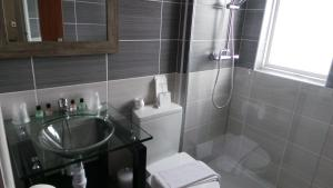 A bathroom at Torbay Court Hotel