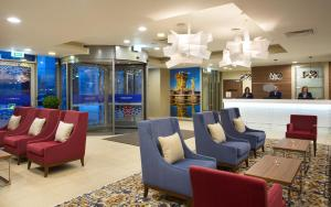 The lobby or reception area at Hampton by Hilton Moscow Strogino