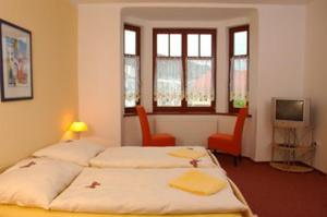 Кровать или кровати в номере Penzion-Apex