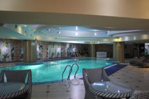 The swimming pool at or near Grand Aiser Hotel