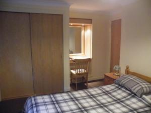 A bed or beds in a room at Coasters Holiday Flats