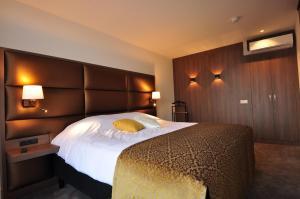 Een bed of bedden in een kamer bij Hotel Terminus