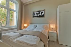 Łóżko lub łóżka w pokoju w obiekcie Imperial Apartments - Cassino