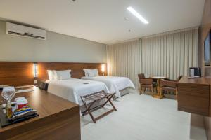 A bed or beds in a room at Hotel Gran Odara
