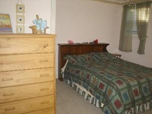 A bed or beds in a room at Saybrook Manor Beach House