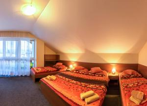A bed or beds in a room at Privat Baja