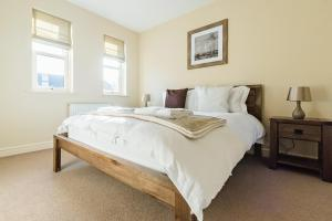 A bed or beds in a room at Camstay New Street