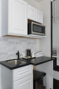A kitchen or kitchenette at The Adrian