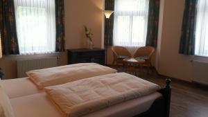 Ein Bett oder Betten in einem Zimmer der Unterkunft Teichhotel