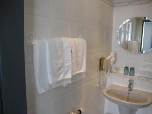 Ein Badezimmer in der Unterkunft Hotel Bergschlößchen