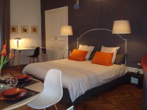 Un ou plusieurs lits dans un hébergement de l'établissement Appartements Caractere Clos St Jean