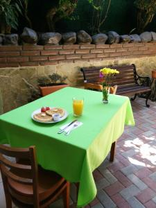 A restaurant or other place to eat at Hotel Casa De Angeles