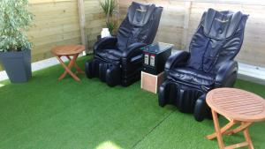 A seating area at Camping des Roses