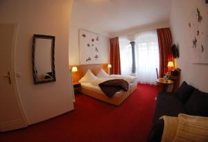 Кровать или кровати в номере Hotel Mohren Post