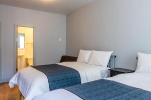 Ein Bett oder Betten in einem Zimmer der Unterkunft The Park Ave North
