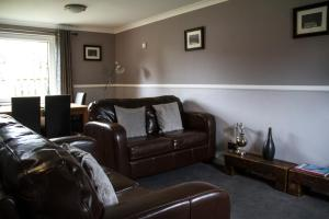 A seating area at Home Farm Apartments
