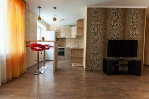 Телевизор и/или развлекательный центр в Апартаменты-студио «На Печорской»