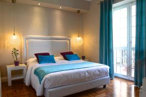A bed or beds in a room at La Villetta Suite