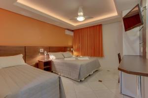 Cama ou camas em um quarto em Hotel Via Serena
