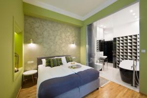 Łóżko lub łóżka w pokoju w obiekcie Apartamenty Pod Orłem