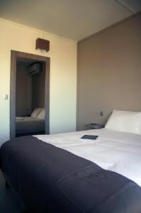 A bed or beds in a room at Hôtel Des Amandiers