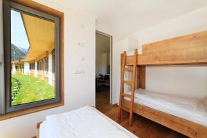 Ein Etagenbett oder Etagenbetten in einem Zimmer der Unterkunft Camping Zögghof