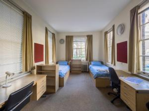 A bed or beds in a room at LSE Passfield Hall