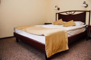 Кровать или кровати в номере Pensjonat Lorien