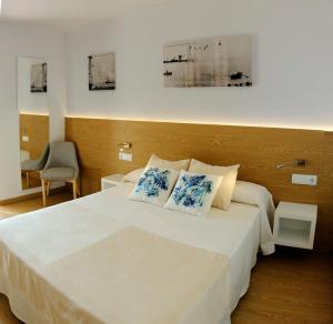 Een bed of bedden in een kamer bij Rosa Naútica