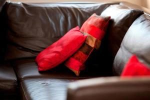 A bed or beds in a room at DBS Serviced Apartments - The Coach House