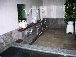 A bathroom at Pension Surf Rider